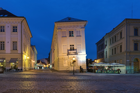 TARTU, ESTONIA - JULY 23, 2016: Leaning House in dusk. It was built in 1793 and began to tilt due to the different materials used in its foundations. After restoration in 1980, falling has suspended.