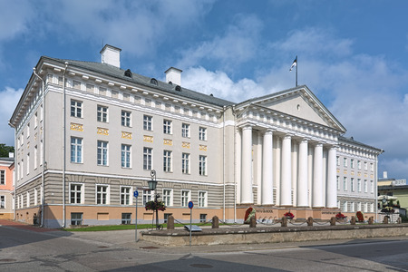 TARTU, ESTONIA - JULY 24, 2016: The main building of Tartu University. The building in the classical style was built in 1804-1809 by design of the German architect Johann Wilhelm von Krause.