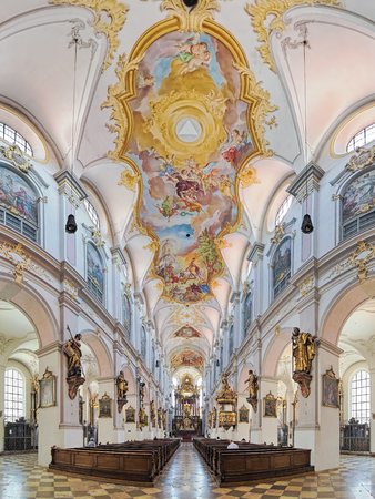MUNICH, GERMANY - MAY 30, 2017: Panorama of interior of St. Peters Church (Alter Peter). This is the oldest church in the city. The present Late Baroque interior was created in the 18th century.