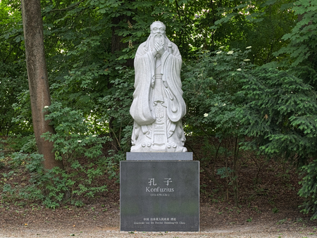 MUNICH, GERMANY - MAY 30, 2017: Confucius statue at Dichtergarten (Garden of Poets). The statue was erected in 2007 as a gift from the Shandong province of the Peoples Republic of China.