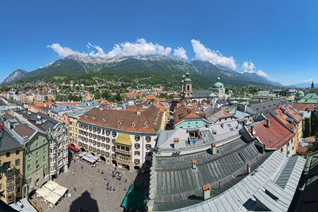 Innsbruck, Austria. Panoramic view over the central, north-western and northern parts of the city with mountains of Karwendel mountain range in the background. View from the tower of the Old Town Hall