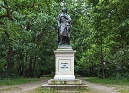 Friedrich Schiller monument at Maximiliansplatz square in Munich, Germany. The monument was unveiled in 1863. It was commissioned by King Ludwig I and designed by the German sculptor Max von Widnmann.