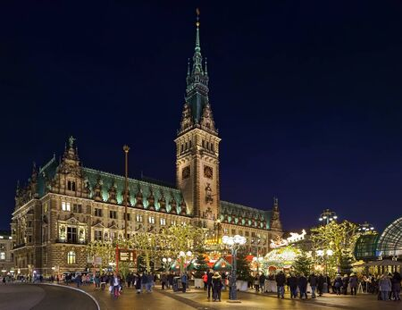 HAMBURG, GERMANY - DECEMBER 5, 2018: Christmas market at Town Hall square in front of Hamburg Town Hall in dusk. This is the most popular and most visited Christmas market of the city.