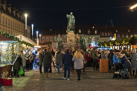 Bamberg, Germany. Christmas market at Maximilian square around Maximilian Fountain. The fountain takes its name from king Maximilian I Joseph of Bavaria. It was created in 1888 by Ferdinand von Miller