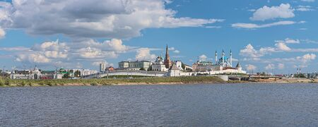 Kazan, Russia. View of Kazan Kremlin with Presidential Palace, Soyembika Tower, Annunciation Cathedral, Qolsharif Mosque. Left of Kremlin: Palace of Farmers. View from the shore of Kazanka river.