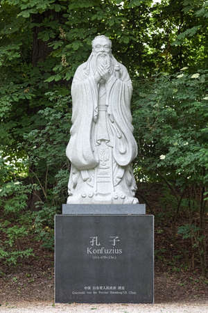Statue of the Chinese philosopher Confucius at Dichtergarten (Garden of Poets) in Munich, Germany. The statue was erected in 2007 as a gift from the Shandong province of the People's Republic of China