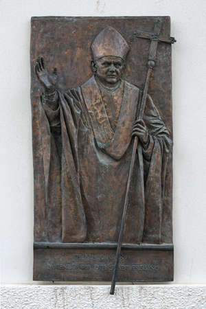 FREISING, GERMANY - DECEMBER 17, 2017: Pope Benedict XVI relief at the entrance to the courtyard of Freising Cathedral. The relief by sculptor Franz Hammerle was inaugurated on November 21, 2010. 에디토리얼