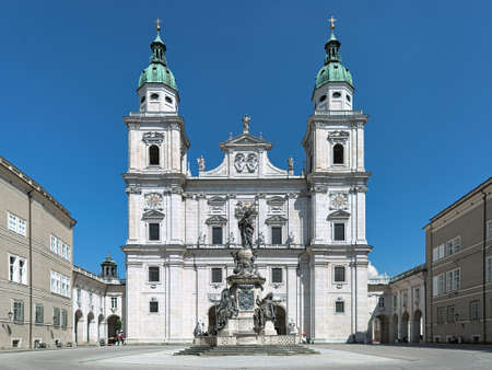 Salzburg Cathedral and Marian column at Domplatz, Austria. The cathedral was founded in 774. Its present Baroque appearance is from the 17th century. The Marian column was erected in 1766-1771.