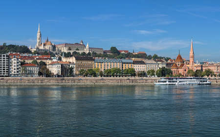 Budapest, Hungary. View on right bank of Danube with Matthias Church and Fisherman's Bastion on Castle Hill and Calvinist Church faced to Danube.