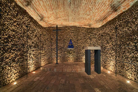 BRNO, CZECH REPUBLIC - DECEMBER 11, 2016: Chapel in the ossuary under Church of St. James. The ossuary holds the remains of over 50 thousand people which makes it the second-largest ossuary in Europe.