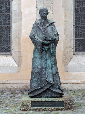 BRAUNSCHWEIG, GERMANY - DECEMBER 7, 2018: Statue of Protestant reformer Johannes Bugenhagen close to Brudernkirche (Brothers Church). The statue by sculptor Ursula Querner was erected in 1970.