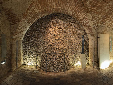 BRNO, CZECH REPUBLIC - DECEMBER 11, 2016: Interior of ossuary under Church of St. James. The ossuary holds the remains of over 50 thousand people which makes it the second-largest ossuary in Europe.