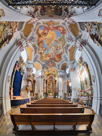 MUNICH, GERMANY - DECEMBER 15, 2017: Vertical panorama of interior of abbey church of St. Anna im Lehel. Church was built in 1727-1733. Interior was completed in 1737 by Asam brothers and J.B. Straub.