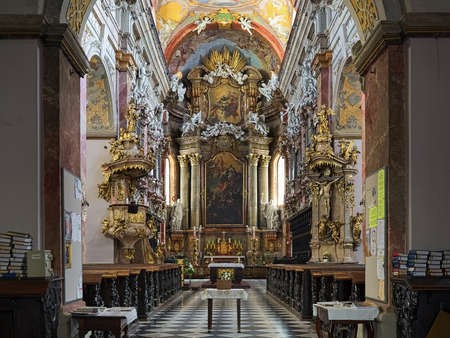 BRNO, CZECH REPUBLIC - JULY 29, 2019: Interior of Church of Assumption of Virgin Mary, also known as Jesuit Church. The church was built in 1598-1602 and modified in the 17th and 18th centuries.