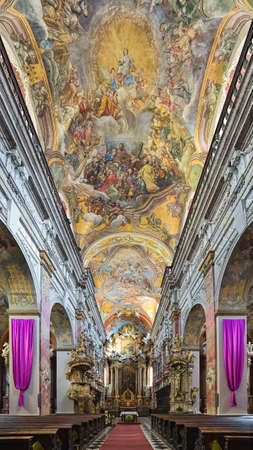 BRNO, CZECH REPUBLIC - DECEMBER 12, 2016: Interior of Church of Assumption of Virgin Mary or Jesuit Church. Church was built in 1598-1602. Ceiling fresco was painted in 1744 by Felix Anton Scheffler. Editorial