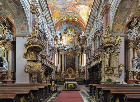BRNO, CZECH REPUBLIC - DECEMBER 12, 2016: Choir and altar of Church of the Assumption of the Virgin Mary or Jesuit Church. The church was built in 1598-1602 and modified in the 17th and 18th centuries