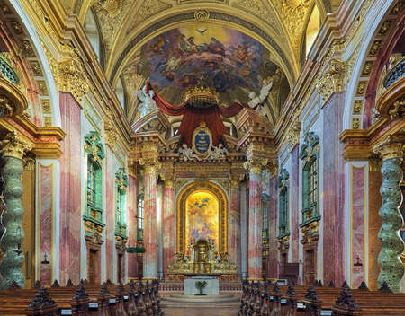 VIENNA, AUSTRIA - DECEMBER 9, 2016: Choir and altar of Jesuit Church. The church was built in 1623-1627. It was remodeled in 1703-1705 by Andrea Pozzo, who also executed the altarpiece and fresco.