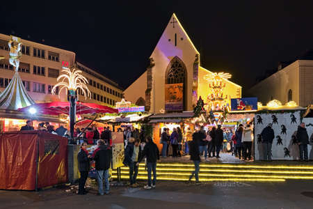 BASEL, SWITZERLAND - DECEMBER 14, 2019: Christmas market at Barfusserplatz square in front of Barfusserkirche (former Franciscan monastery church). This is the largest Christmas market in the city. Editorial