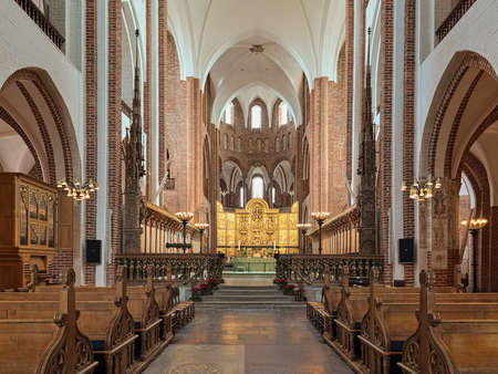 ROSKILDE, DENMARK - DECEMBER 14, 2015: Interior of Roskilde Cathedral. Since the Protestant Reformation in 16th century all Danish kings and almost all queens have been buried in Roskilde Cathedral.