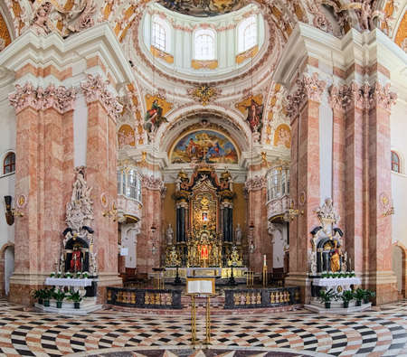 INNSBRUCK, AUSTRIA - MAY 26, 2017: Chancel, choir and High altar of Innsbruck Cathedral. Cathedral was built in 1717-1724. High altar was created in 1729 by Cristoforo Benedetti and his son Teodoro.