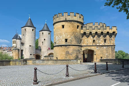 Germans' Gate (Porte des Allemands) in Metz, France. This is the medieval fortified bridge with two round towers of the 13th century and two gun bastions of the 15th century.