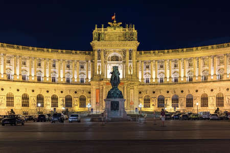 VIENNA, AUSTRIA - DECEMBER 10, 2016: Neue Burg wing of Hofburg Palace and Prince Eugene of Savoy equestrian statue in night. Statue by sculptor Anton Dominik Fernkorn was unveiled on October 18, 1865.