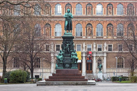 VIENNA, AUSTRIA - DECEMBER 10, 2016: Schiller monument on Schillerplatz square in front of the main building of Academy of Fine Arts. Monument was erected in 1876. The building was built in 1871-1876. Editorial
