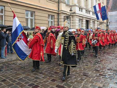 ZAGREB, CROATIA - OCTOBER 8, 2018: Honorary Company of the Honor Guard Battalion marches with National flag along the Croatian Parliament building during the celebration of Croatian Independence Day.