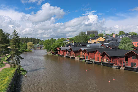 Porvoo Old Town with old wooden barns alongside the Porvoonjoki river, Finland. View from a bridge across the river.