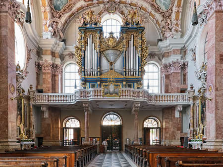 INNSBRUCK, AUSTRIA - MAY 26, 2017: Main organ of Innsbruck Cathedral (Cathedral of St. James). The cathedral was built in 1717-1724. The organ was built in 1725 and reconstructed in 1998-2000.
