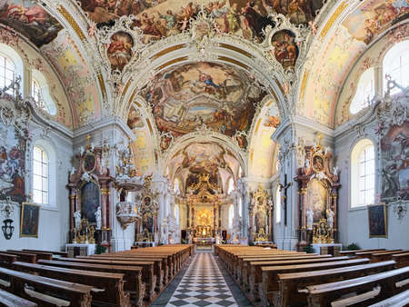 INNSBRUCK, AUSTRIA - MAY 27, 2017: Panoramic view of interior of Wilten Basilica. The rococo interior was created in 1751-1756 by Franz Xaver Feuchtmayer, Anton Gigl and Matthaus Gunther. Editorial