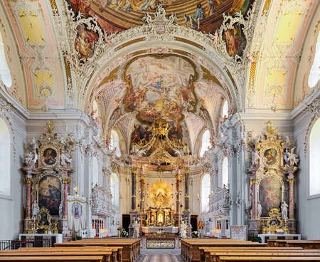 INNSBRUCK, AUSTRIA - MAY 27, 2017: Interior of Wilten Basilica. The rococo interior, including ceiling paintings, was created in 1751-1756 by Franz Xaver Feuchtmayer, Anton Gigl and Matthaus Gunther. Editorial