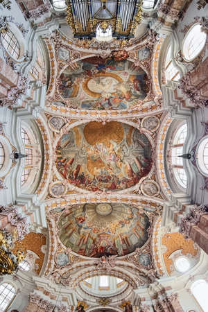 INNSBRUCK, AUSTRIA - MAY 26, 2017: Ceiling fresco of Innsbruck Cathedral (Cathedral of St. James). The fresco with scenes from the life of Saint James was executed in 1722-1724 by Cosmas Damian Asam.