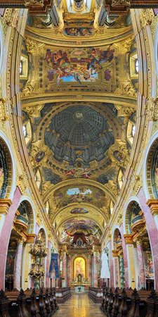 VIENNA, AUSTRIA - DECEMBER 9, 2016: Vertical panorama of interior of Jesuit Church. The church was built in 1623-1627. It was remodeled in 1703-1705 by Andrea Pozzo, who also executed ceiling fresco.