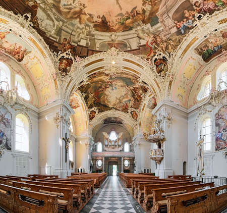 INNSBRUCK, AUSTRIA - MAY 27, 2017: Panoramic view of interior of Wilten Basilica. The present church was built in 1751-1756. The rococo interior was created in 1751-1756. The organ was built in 1894.