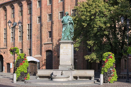 Nicolaus Copernicus Monument in Torun, Poland. The monument was erected in 1853. Latin text on the pedestal reads: Nicolaus Copernicus of Torun, mover of the earth, stopper of the sun and heavens.