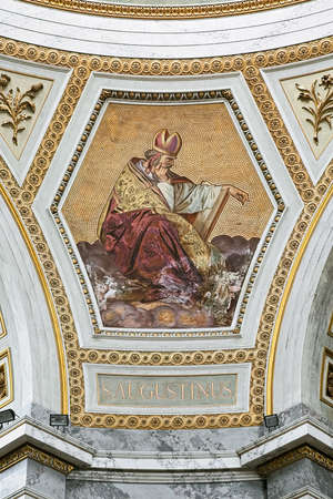 ESZTERGOM, HUNGARY - OCTOBER 7, 2015: Mosaic and fresco depicting Saint Augustine, one of the Four Great Fathers of Western Church, in Esztergom Basilica. Fresco was created by Ludwig Moralt in 1840s.