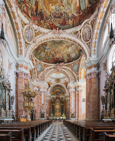 INNSBRUCK, AUSTRIA - MAY 26, 2017: Interior of Innsbruck Cathedral. The cathedral was built in 1717-1724. The interior, including ceiling fresco, was created by Asam brothers in 1722-1724.