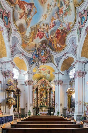 MUNICH, GERMANY - DECEMBER 15, 2017: Interior of abbey church of St. Anna im Lehel. Church was built in 1733 by Johann Michael Fischer. Interior was completed in 1737 by Asam brothers and J.B. Straub.