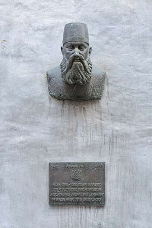 ERFURT, GERMANY - DECEMBER 12, 2018: Bronze bust of the German mathematician Adam Ries (1492-1559). The monument by sculptor Michael Lenz was unveiled in 2002.