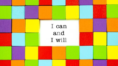 I Can and I Will typed on white paper surrounded by multi colored blocks in a conceptual image of inspiration and motivation.