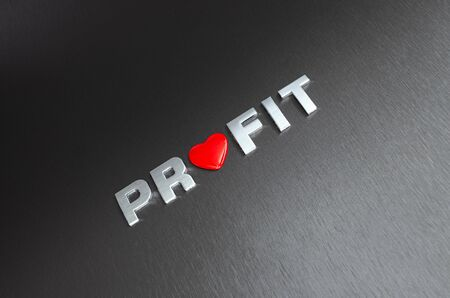 Concept of loving your financial profits. Letters on aluminium background with red heart shape replacingh the letter o Imagens
