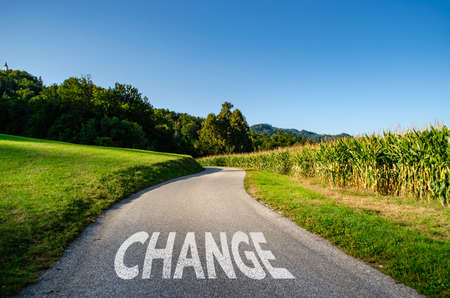 Word CHANGE painted on the road in white colour, concept for road to change Standard-Bild