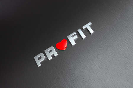 Concept of loving your financial profits. Letters on aluminium background with red heart shape replacingh the letter o
