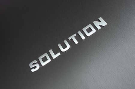 Word solution spelled diagonally with chrome letters on aluminium background