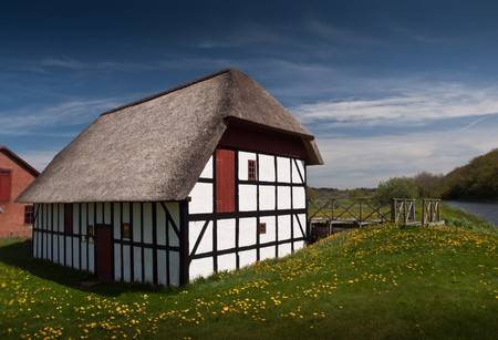 watermill: Historical timberframed danish watermill captured in summertime. Stock Photo