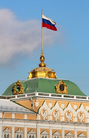 Fragment of Big Palace of Moscow Kremlin with Russian flag