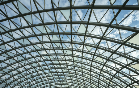 architecture, hemisphere, metal construction of the glass roof of the shopping center.