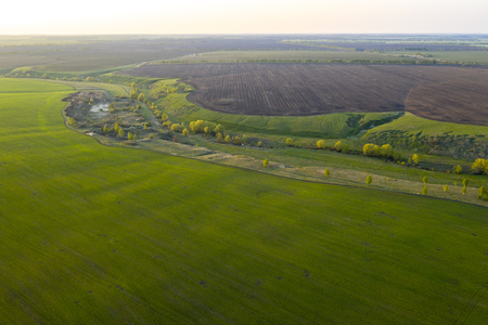 Spring fields, meadows, ravines at sunset from the quadrocopter