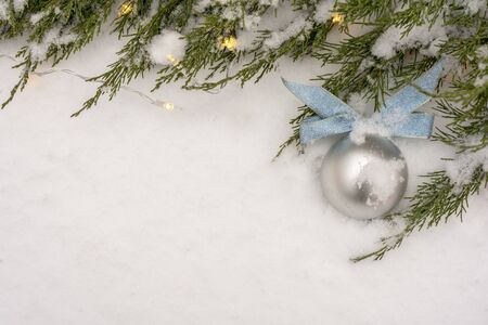 Christmas and New Year background. Snowflake, Christmas tree and ball on a white wooden background. Copy space.